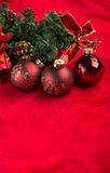 Red christmas balls on red background Stock Photos