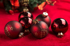 Red christmas balls on red background Royalty Free Stock Photography