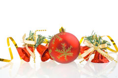 Red Christmas balls and red hand bells. Red Christmas balls and bells isolated on white background Stock Photography