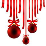 Red Christmas balls and ribbon. Hanging red Christmas balls and ribbon arranged in a decorative display Royalty Free Stock Image