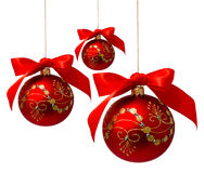 Red christmas balls with ribbon isolated on a white Stock Image