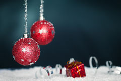 Red christmas balls,ribbon and snow Royalty Free Stock Photography