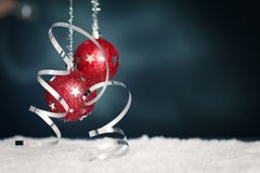 Red christmas balls,ribbon and snow Stock Photos
