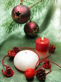 Red christmas balls and scented candles Royalty Free Stock Image