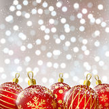 Red Christmas balls on shiny background Royalty Free Stock Images