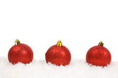 Red christmas balls with snow Stock Images