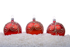 Red christmas balls with snow Royalty Free Stock Images