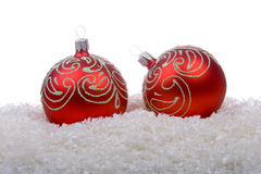 Red christmas balls with snow Stock Photography