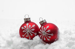 Red Christmas balls in snow Stock Photos