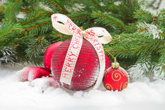 Red christmas balls in snow Royalty Free Stock Image