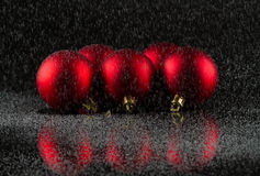 Red Christmas balls and snow... Stock Photo