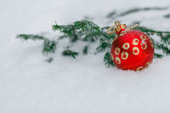 Red christmas balls on a snow. New Year greeting card concept. C Royalty Free Stock Images