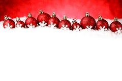 Red christmas balls on snow Royalty Free Stock Photos