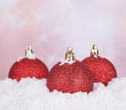 Red Christmas Balls in Snow Royalty Free Stock Images