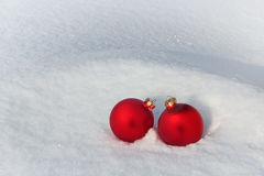 Red Christmas Balls in the Snow Stock Images