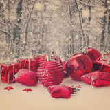 Red christmas balls in snowed forest Stock Image