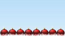 Red christmas balls in snowflakes Royalty Free Stock Image