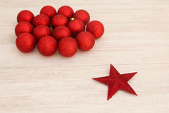 Red Christmas balls and star with glitter Stock Image