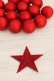 Red Christmas balls and star with glitter Royalty Free Stock Photography