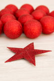 Red Christmas balls and star with glitter Royalty Free Stock Images