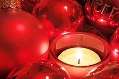 Red Christmas balls and tea light Stock Photography