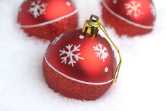 Red Christmas balls on white snow Royalty Free Stock Images