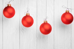 Red Christmas Balls on white wooden background Stock Image