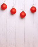 Red Christmas Balls on white wooden background Royalty Free Stock Photography