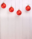 Red Christmas Balls on white wooden background Stock Photos