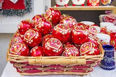Red Christmas balls in wicker basket. Hand painted with traditional Croatian decorations Royalty Free Stock Photo