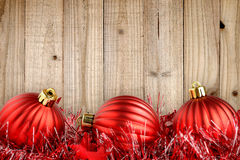 Red christmas balls on wood Royalty Free Stock Image