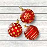 Red christmas balls on wood Stock Photo