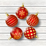 Red Christmas balls on wooden background. Christmas balls on wooden background Royalty Free Stock Images