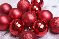 Red christmas balls on a wooden background Royalty Free Stock Photography