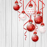 Red Christmas balls on wooden background Royalty Free Stock Images