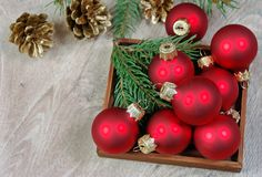 Red christmas balls on the wooden table and fir branches. copy spaces. stock image