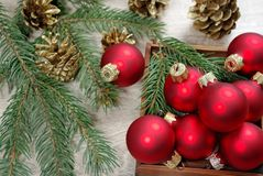 Red christmas balls on the wooden table and fir branches. copy spaces. royalty free stock photo