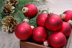 Red christmas balls on the wooden table and fir branches. copy spaces. royalty free stock photography