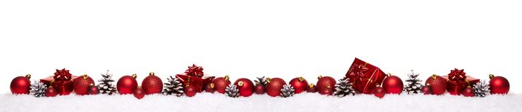 Red christmas balls with xmas present gift boxes in a row isolated on snow. Christmas banner