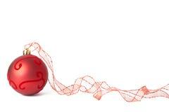 Red Christmas bauble. One red Christmas bauble with ribbon isolated on white background Stock Images