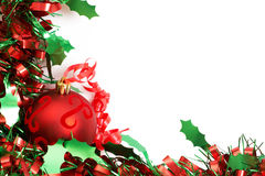 Red Christmas bauble. Three red Christmas bauble on green tinsel Royalty Free Stock Image