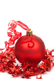 Red Christmas bauble. One red Christmas bauble with star tinsel Royalty Free Stock Images