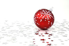Red Christmas Bauble. With silver stars on the floor Royalty Free Stock Photography