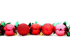 Red Christmas Bauble Border. With Garland over a white background stock photos