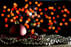Red Christmas bauble in the dark Stock Photography