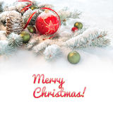 Red Christmas bauble on decorated fir twigs in snow, text space Royalty Free Stock Photos