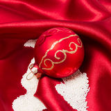 Red Christmas bauble decorating with sugar as snow Royalty Free Stock Photos