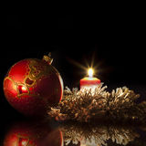 Red christmas bauble in the evening Royalty Free Stock Images