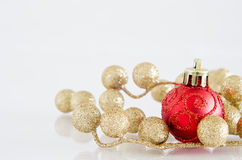 Red Christmas Bauble with Gold Glitter Balls Royalty Free Stock Images