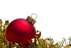 Red christmas bauble with gold tinsel Stock Photography